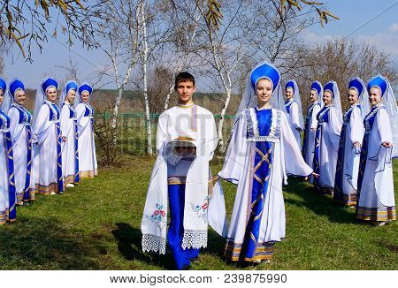 Voronezh / Russia - April 17, 2014: A Dance Collective With Russian Bread And Salt Among The Birches