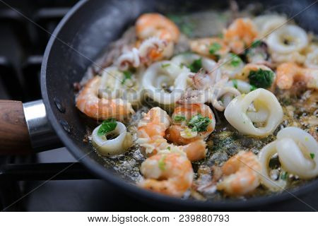 frying seafood in pan