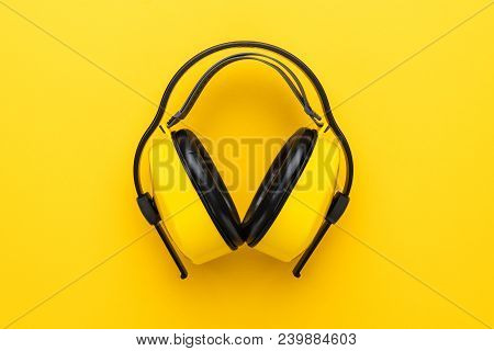 Hearing Protection Industrial Ear Muffs. Top View Of Ear Muffs. Ear Muffs On Yellow Background. New