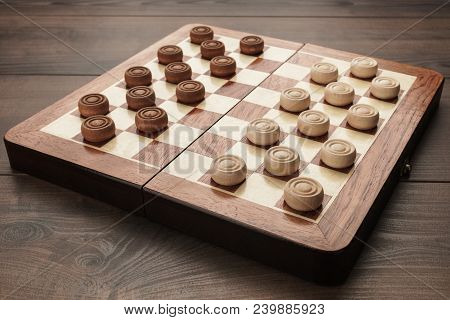 Wooden Draughts Game. Draughts On Brown Table. Wooden Draughts Ready For A Game. Classical Draughts