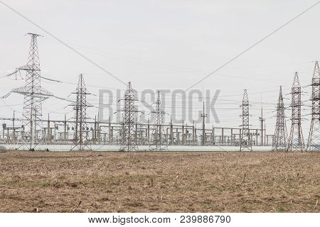Photo Of Power Plant. Power Plant With Electric Towers In Spring. Landscape Photo With Power Plant.