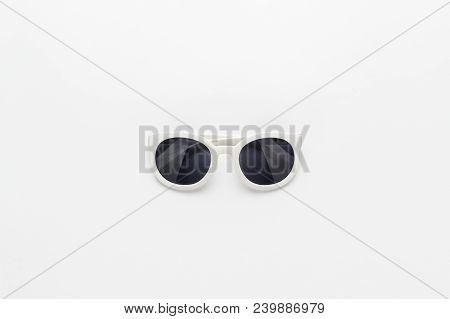 Studio Shot Of White Sunglasses. White Sunglasses Not Isolated. Top View Of White Sunglasses. Centra