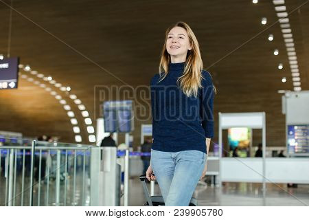Woman Walking With Valise At Airport Hall. Concept Of Traveling Abroad And Gladden Passenger.
