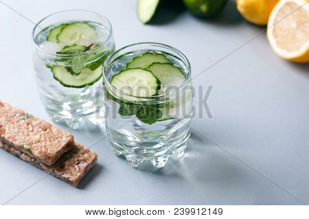 Detox Water Infused With Sliced Cucumber And Springs Of Mint, Copy Space