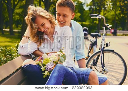 Attractive Young Couple On A Dating In A Summer Park.