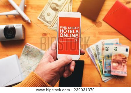 Find Cheap Hotels Online Mobile Phone App. Overhead View Of Man Holding Smartphone And Searching Aff