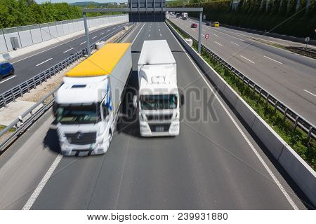 Truck Begins Overtaking Maneuver On A German Autobahn