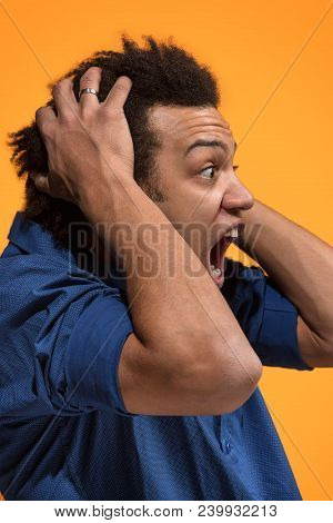 Screaming, Hate, Rage. Crying Emotional Angry Man Screaming On Orange Studio Background. Emotional,