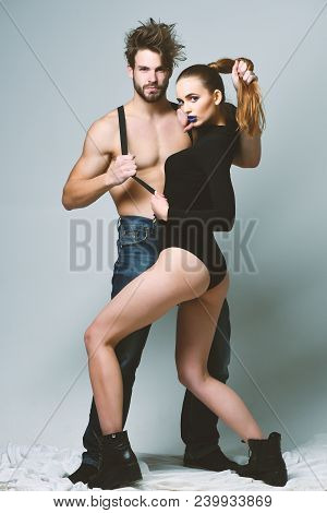 Sexy Couple In Love With Half Naked Bodies. Man And Pretty Girl With Seductive Faces On Grey Backgro