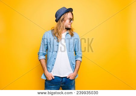 Portrait Of Handsome, Confident, Young Guy  Standing On The Yellow Background, Holding Hands In Pock