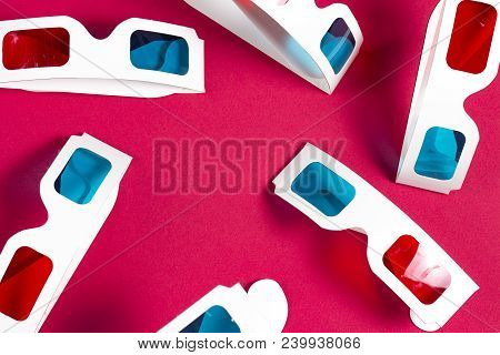 Paper 3d Glasses On Pink Background. Film Concept. Cinema In 3d. Watching Movie In The Cinema. Many