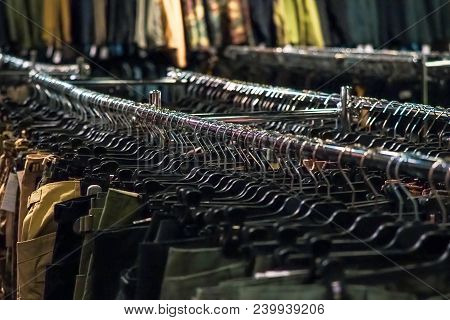 Things Are Clothes On Hangers In A Trendy Clothes Store. Clothes On A Hanger In A Fashion Boutique.