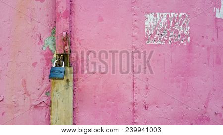 Corroded Old Pink Plank Door With Lock