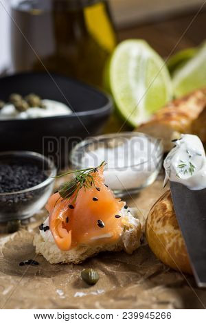 Piece Of Bread With Smoked Salmon, Cream Cheese, Fresh Dill And Black Sesame. Finger Food.