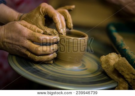 Sculpts In Clay Pot Closeup. Modeling Clay Close-up. Caucasian Man Making Vessel Daytime Of White Cl