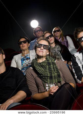 Cinema Spectators With 3D Glasses