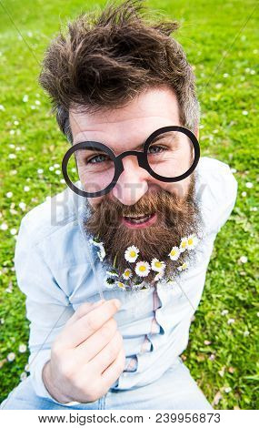 Man With Long Beard And Mustache, Defocused Green Background. Hipster With Beard On Cheerful Face, P