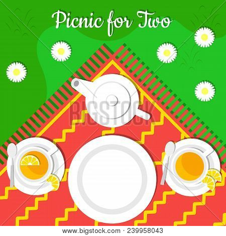 Picnic For Two. Top View. Green Grass, Camomile, Tablecloth, Empty Plates, Two Sets For Tea With Lem