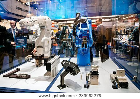 Hannover, Germany - April, 2018: Mitsubishi And Yaskawa Robot Arms On Schunk Stand On Messe Fair In