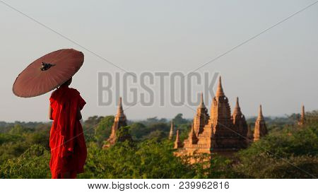 Monk Standing With Holding Umbrella, Bagan Mandalay Myanmar