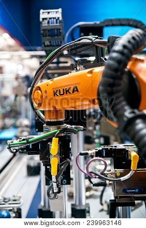Hannover, Germany - April, 2018: Kuka Robot On Schunk Assembly Electronics Line On Messe Fair In Han