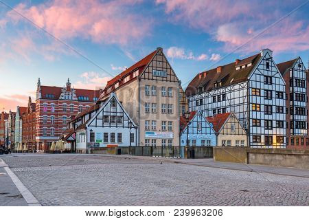 Gdansk, Poland - May 5, 2018: Architecture of the old town in Gdansk at sunrise, Poland. Gdansk is the historical capital of Polish Pomerania with beautiful architecture.
