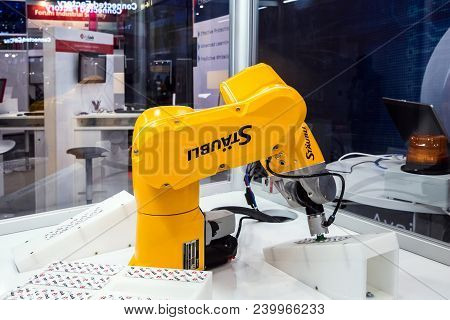 Hannover, Germany - April, 2018: Automatic Staubli Industrial Robot On Messe Fair In Hannover, Germa