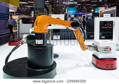 Hannover, Germany - April, 2018: Kuka Industrial Robot On Huawei Booth Stand On Messe Fair In Hannov