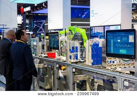 Hannover, Germany - April, 2018: Industrial Assembly Line With Robots Powerded By Cosmoplat On Messe