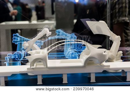 Hannover, Germany - April, 2018: Simulating Of Car Manufacturing By Robots, Digital Twin Of The Prod
