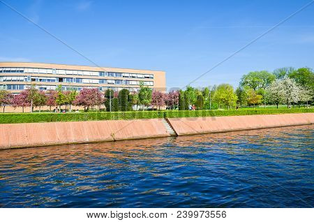 Berlin, Germany - April 22, 2018: One Of The Banks Of The River Spree Magnus-hirschfeld-ufer With Fl