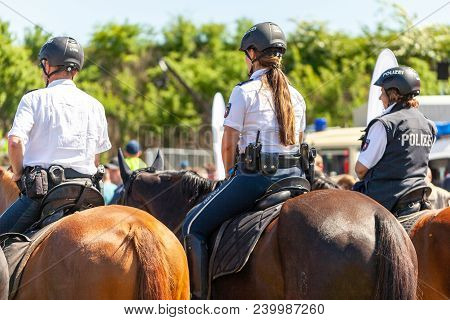 Delmenhorst / Germany - May 6, 2018: German Police Horsewoman Rides On A Police Horse For Training E