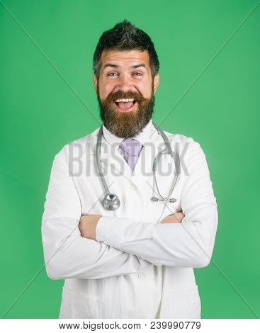 Physician, Pharmacist, Bearded Doctor With Stethoscope Standing With Folded Arms. Medical Care, Phar