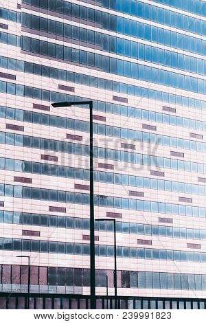 Glass Facade Of An Office Skyscraper Under Construction: Plenty Of Dusty Windows Of Empty Offices, T