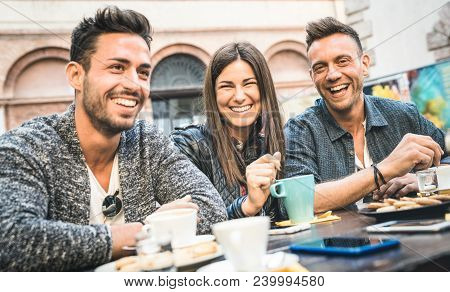 Happy Friends Talking And Having Fun At Pub Restaurant Drinking Cappuccino And Hot Tea - Young Peopl