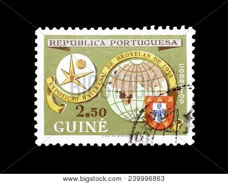 Guinea - Circa 1958 : Cancelled Postage Stamp Printed By Guinea, That Shows Earth And Expo-emblem Br