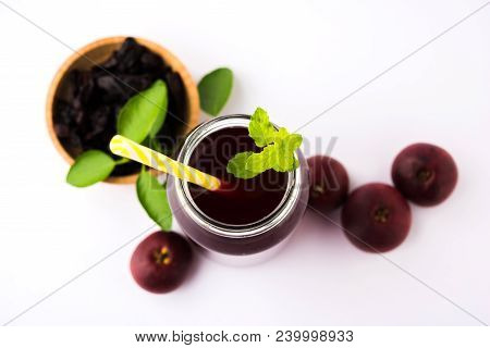 Kokum Sharbat, Juice or Sherbet OR summer coolant drink made up of Garcinia indica with raw fruit, served in a glass with mint leaf. selective focus poster
