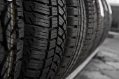 Protector of automobile tires. A number of automobile tires. Close up view on auto mobile new wheel tire surface. Different pattern and type tires for car industry commercial transport transpotration poster