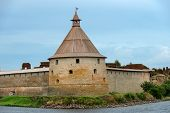 The Golovkina Tower of the Fortress of Oreshek. Fortress in the source of the Neva River, Russia, Shlisselburg:  Medieval Russian defensive structure and political prison. Fortress walls and towers. It was founded in 1323. poster