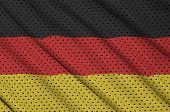 Germany flag printed on a polyester nylon sportswear mesh fabric with some folds poster