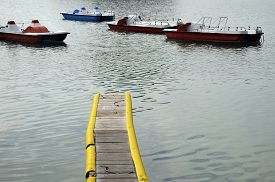 Pedalo, Pedalboats And Yellow Pontoon On Annecy Lake, France