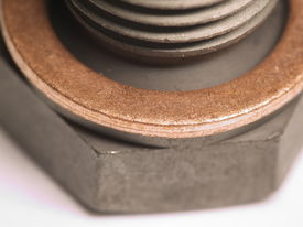 Red Copper Washer On Steel Screw Bolt