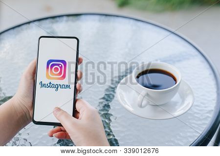 Chiang Mai, Thailand - Oct.18,2019: Woman Holding Xiaomi Mi Mix 3 With Instagram App  On Screen At C