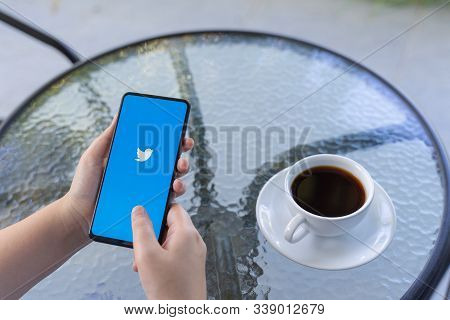 Chiang Mai, Thailand - Oct.18,2019: Woman Holding Xiaomi Mi Mix 3 With Twitter App On The Screen.twi