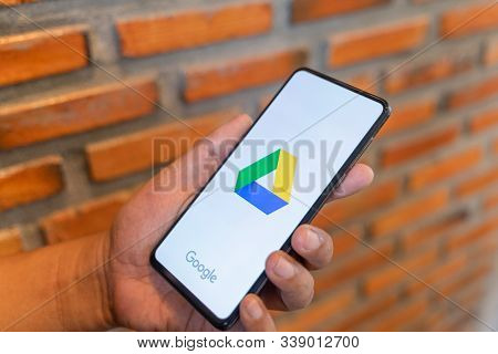 Chiang Mai, Thailand - Aug.24,2019:  Man Holding Xiaomi Mi Mix 3 With Dropbox On Screen.dropbox Is A