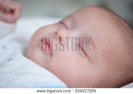 Close Up Photo Of Cute Sleeping Newborn Baby, Face.