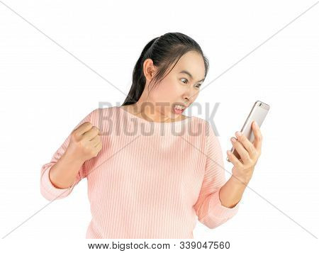 Asian Woman Angry And Furious What She See In The Smartphone, Isolated On White Background.