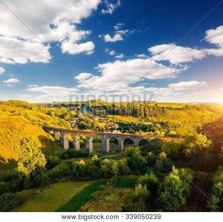 Aerial view of old viaduct. Location Ukraine, Europe. Scenic image of popular european tourist attraction. Famous historical place. Drone photography. Idyllic wallpaper. Discover the beauty of earth.
