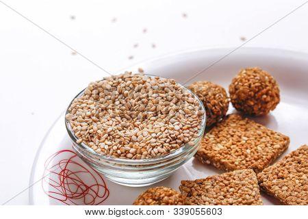 Til Gul Or Sweet Sesame Laddu For Indian Festival Makar Sankranti Over White Background