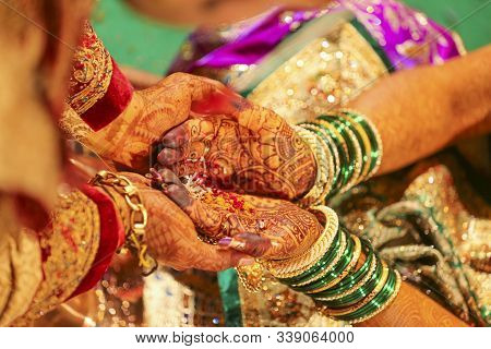 Beautiful Indian Bride Hand With Mehandi Design And Jewelry
